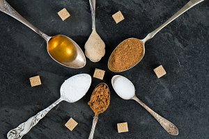 Different Kinds of Sugar in Spoons