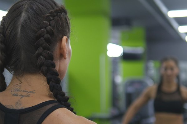Woman trains in the gym