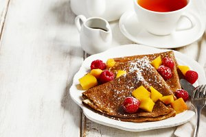 Crepes with mango and raspberries