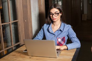 woman is working with laptop
