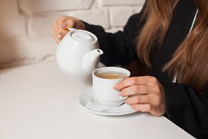 woman in cafe drinking tea