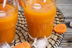 Carrot juice with ice in a transparent glass
