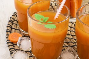 Fresh carrot juice with pulp with ice and mint leaf