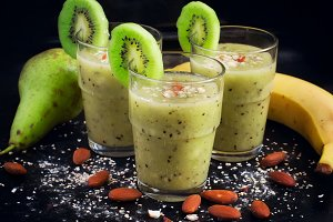 Healthy smoothie drink with fruit, almond and oat bran