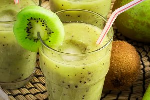 Refreshing ice smoothie with kiwi, banana and pear