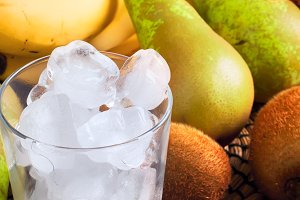 Ingredients for green smoothies: bananas, kiwi, pears and ice
