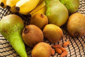 Set of fruits on a round wicker napkin