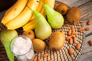 Ingredients for smoothies: bananas, kiwi, pears and ice