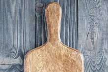 Empty cutting board on wooden background, copy space, top view
