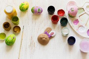 paint bunny and eggs on the table. Top view