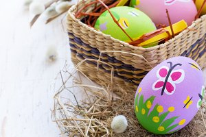 Painted Easter eggs with spring patterns on a white background,