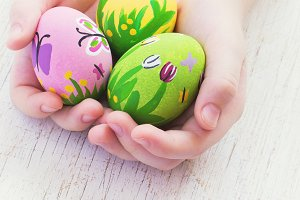 Painted Easter eggs in the children's hands