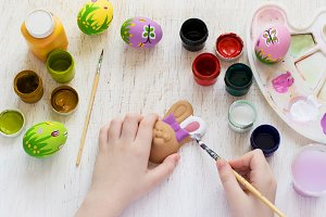 Children's hand painted Easter bunny and eggs