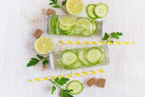 Lime, cucumber, parsley lemonade in bottles on a white backgroun