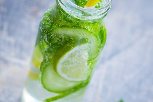 Mint, lime and cucumber detox drink, selective focus