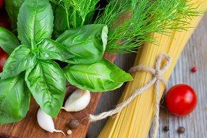 Spaghetti, cherry tomatoes and basil - Italian food concept