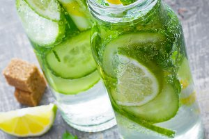 Lime, mint, cucumber cocktail with bottles, lemonade, detox wate