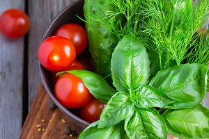 Fresh basil on a background of vegetables, selective focus