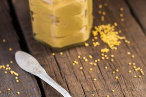 Home mustard sauce in a spoon, selective focus