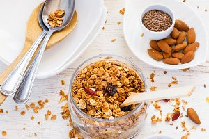 Homemade muesli, honey, nuts and milk. healthy breakfast concept