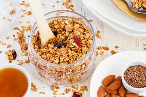 Healthy breakfast. Granola, almonds, milk and honey on a white b