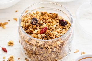 healthy breakfast. Fresh granola with goji and honey on a white