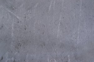 Heterogeneous concrete background with traces of spatula