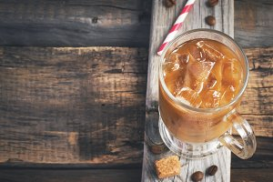 Coffee with ice in a glass, selective focus, top view, space for