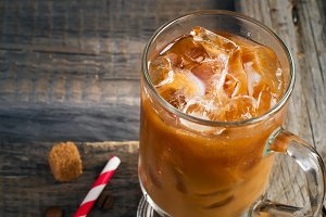 Coffee with ice in a glass, selective focus, space for text