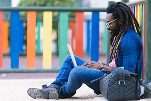African Young Man Using Laptop.