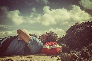 Man resting on beach