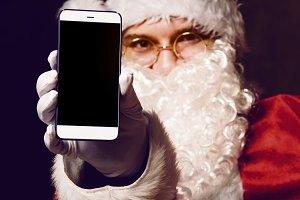 Santa Claus holding smartphone