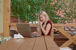 Young woman communicate using laptop