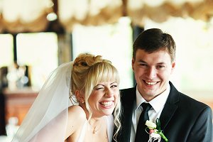 Bride laugh with groom