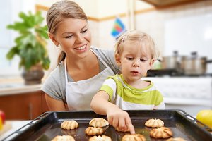Housewife with daughter baking