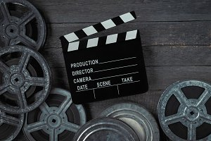 Clapperboards  and reel of film