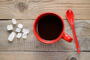 Coffee cup, spoon and rock sugar
