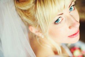 Deep blue eyes of blonde bride