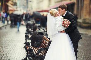 Groom bends bride on the street
