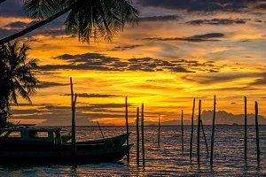 Sunset on Kri Island. Some Boats in Foreground. Raja Ampat, Indonesia, West Papua