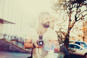 handsome man using film camera
