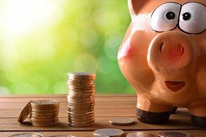 Closeup piggy bank with coins