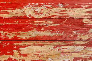 Peeled old red wooden wall