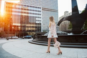 woman with long legs walking in city
