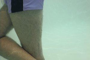 Man underwater in pool