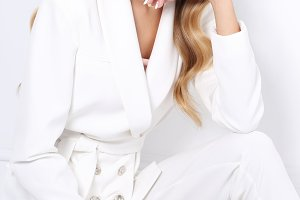 young woman in white suit