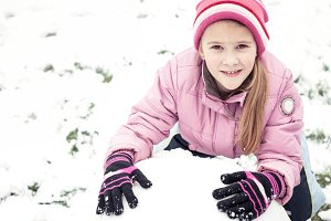 Little girl playing in snow.