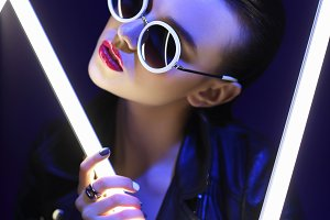 young elegant woman in sunglasses