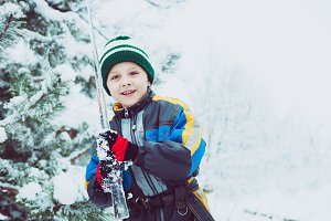 Little boy playing in snow.