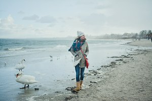 Girl Walking on the Winter Beach
